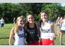 Ella Burgener, Katrina Wynne, and Gwenyth Altman prepare to show off their Clark determination at a South Fork cross country meet